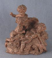 Angelitos, grupo en terracota avs.